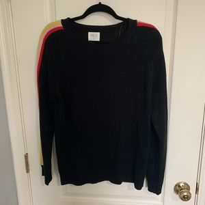 Black sweater with rainbow stripe on sleeves